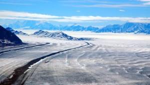 miles-of-glaciers-stretch-beyond-barren-land-in-alaska